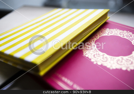 Two colorful books stock photo, Picture of yellow and pink colored books by JRstock