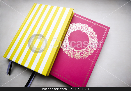 Two books placed together stock photo, Image of two yellow and pink colored books placed together by JRstock