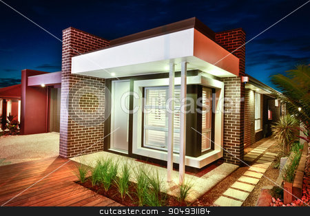 A beautiful picture of a house taken at night  stock photo, A beautiful picture of a house taken at night with plants and garden around the house looking romantic and moody by JRstock