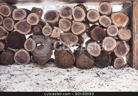 A pile of wood stock photo, A pile of wood arranged on the ground outdoors by JRstock
