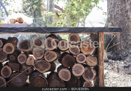 A pile of wood under a table stock photo, Image of a pile of wood arranged under a table outside, taken at daytime by JRstock