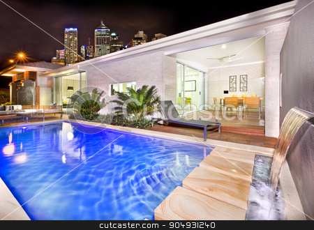 A moody and stylish image of a house pool with beautiful city be stock photo, A moody and stylish image of a house pool with beautiful city behind the house in night by JRstock