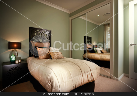 Beauitful bedroom with moody lighting stock photo, A picture of a beautiful bedroom with single bed and moody lighting with a table placed on left and a mirror on right side of bed. by JRstock