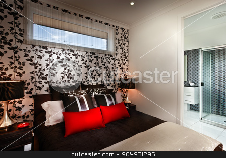 A beautiful romantic bedroom with multi colours cushions and att stock photo, A beautiful romantic bedroom with red cushions and side tables placed on boht sides with attached washroom by JRstock