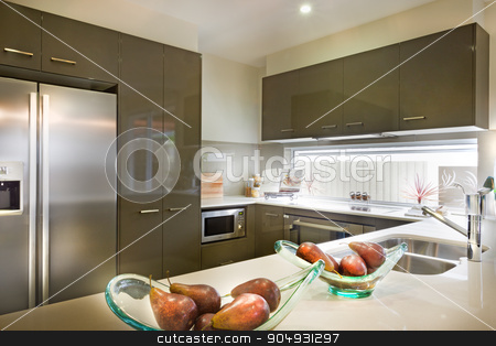 Stylish and modern picture of a kitchen with food placed on shel stock photo, Stylish and modern picture of a kitchen with food placed on shelf and electronic items fixed in wooden  outfit by JRstock