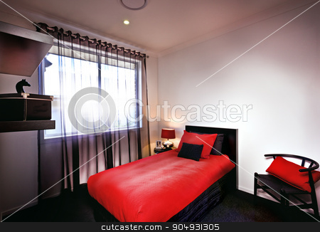 A stylish bedroom with red bedsheet and cushions and pillows pla stock photo, A stylish bedroom with red bedsheet and cushions and pillows placed on bed with lamp and curtains on the the window by JRstock
