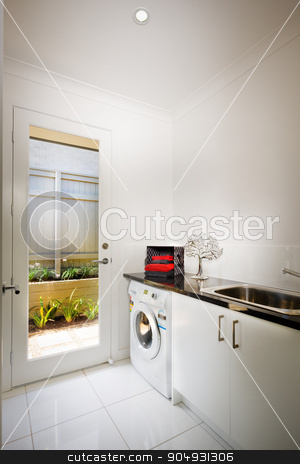 Beautiful washing room with a washing machine stock photo, Beautiful washing room with a washing machine and a sink by JRstock