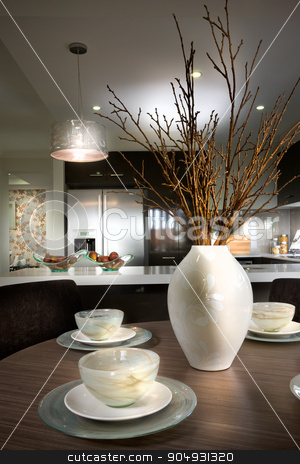 Picture of a kitchen with anituqes placed on dining table stock photo, Picture of a kitchen with antique flower pot and cups placed on dining table by JRstock