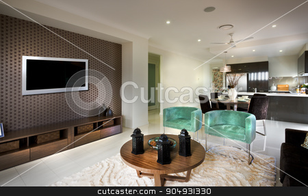 A beautiful decent moody living room with a tv and attached kitc stock photo, A beautiful decent moody living room with a tv and attached kitchen with chairs and antiques placed on a  tablle in front of tv by JRstock