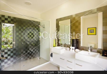 A stylish modern washroom with a glass shower and mirrors on sid stock photo, A stylish modern washroom with a glass shower and mirrors and sinks on right side. by JRstock