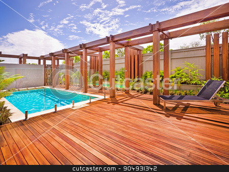 A beautiful view of pool in house in  a sunny day  stock photo, A beautiful view of pool in house in  a sunny day  with wooden floor with a bench by JRstock