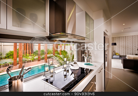 A stylish beautiful kitchen with living room attached stock photo, A stylish beautiful kitchen with living room attached and view of water pool is visible from kitchen by JRstock
