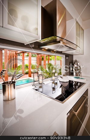 A stylish modern beautiful kitchen  stock photo, A stylish beautiful kitchen  and view of water pool is visible from kitchen by JRstock