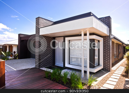 A beautiful outside view  of house  with wooden floor and garden stock photo, A beautiful house view with wooden floor and garden around it and a garage on left side with windows on front of house. by JRstock