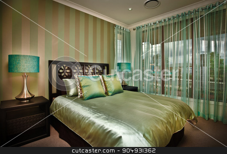 Beautiful image of bedroom stock photo, A beautiful picture of a moody bedroom with golden bedsheet by JRstock