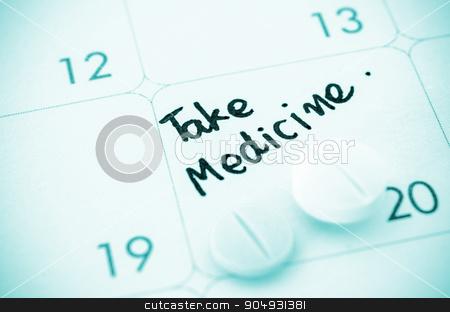 Reminder take medicine on calendar. stock photo, Reminder take medicine written and Medicine pills on calendar. by Miss. PENCHAN  PUMILA