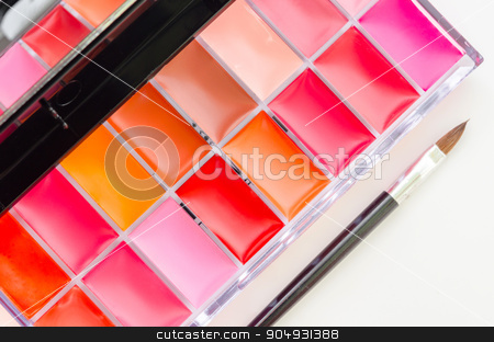 Lipstick and lipgloss makeup palette. stock photo, Lipstick and lipgloss makeup palette isolated on white background. by Miss. PENCHAN  PUMILA