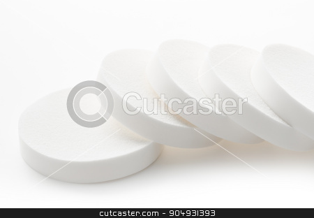 White cosmetic circle sponges for makeup. stock photo, White cosmetic circle sponges for makeup on white background by Miss. PENCHAN  PUMILA