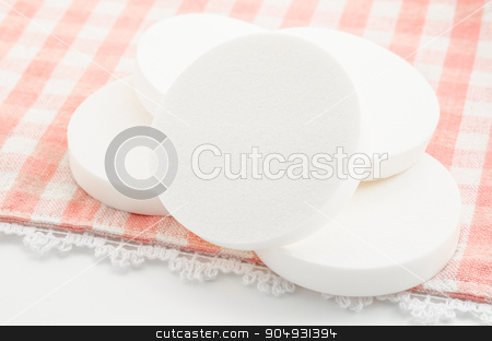 White cosmetic circle sponges for makeup. stock photo, White cosmetic circle sponges for makeup on tablecloth. by Miss. PENCHAN  PUMILA