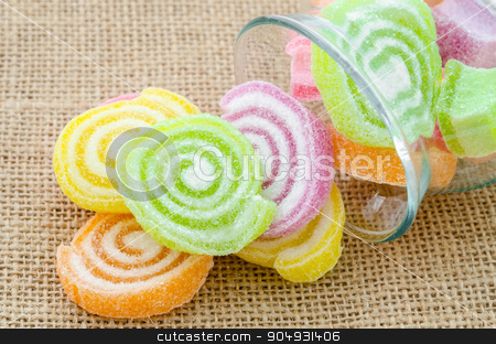Sweet sugar candies. stock photo, Sweet sugar candies in glass bottle on sack background. by Miss. PENCHAN  PUMILA