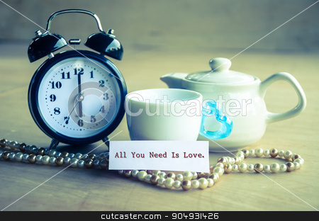 All you need is love concept. stock photo, Vintage all you need is love and alarm clock with set bowl coffee on wooden background. by Miss. PENCHAN  PUMILA