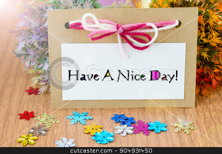 Have a nice day. stock photo, Have a nice day paper card on wooden background. by Miss. PENCHAN  PUMILA