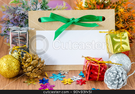 Blank tag paper with decorate christmas. stock photo, Blank tag paper with decorate christmas on wood background for your text. by Miss. PENCHAN  PUMILA