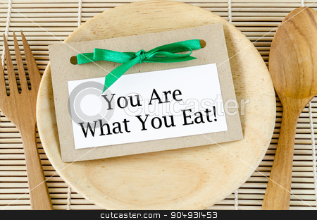 Healthy lifestyle concept. stock photo, Healthy lifestyle concept - you are what to eat reminder words  in paper tag on dish and spoon wooden. by Miss. PENCHAN  PUMILA