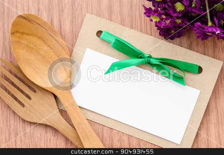 Blank paper tag and wooden spoon with flower. stock photo, Blank paper tag and wooden spoon with flower on wooden background. by Miss. PENCHAN  PUMILA