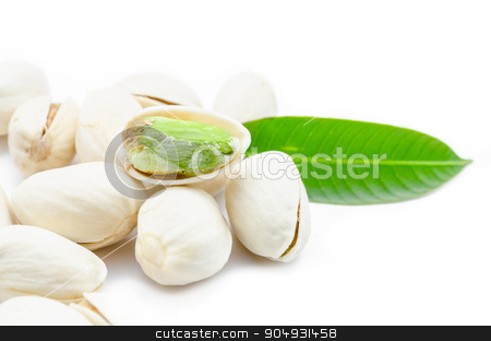 Pistachio nuts. stock photo, Pistachio nuts with green leaf on white background. by Miss. PENCHAN  PUMILA