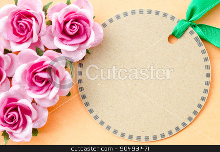 Blank brown paper tag and pink rose for your text. stock photo, Blank brown paper tag and pink rose for your text on orange color background. by Miss. PENCHAN  PUMILA