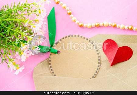 Blank brown paper tag and red heart paper with flower. stock photo, Blank brown paper tag and red heart paper with flower on pink background. by Miss. PENCHAN  PUMILA