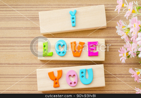 Colorful alphabet of LOVE wording on wooden background. stock photo, Colorful alphabet of LOVE wording with flower on wooden background. by Miss. PENCHAN  PUMILA