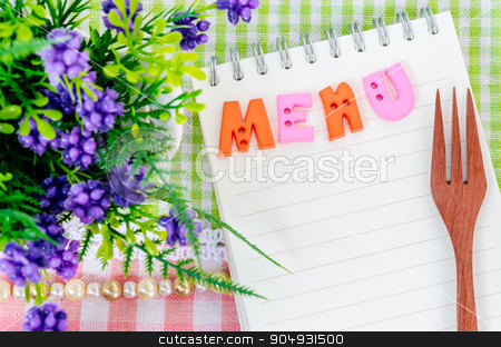 Menu concept. stock photo, Open diary and wooden spoon fork with flower on beautiful fabric background. Menu concept. by Miss. PENCHAN  PUMILA