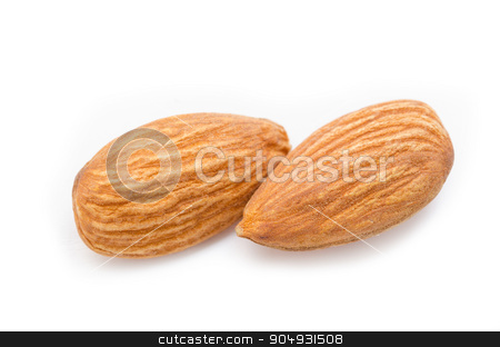 Close up almonds isolated on the white  stock photo, Close up almonds isolated on the white background by Miss. PENCHAN  PUMILA