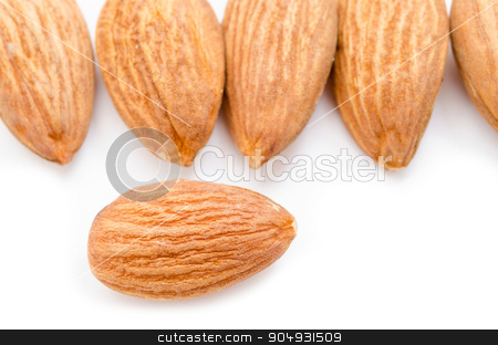 Almond stock photo, Many raw almond on white background. by Miss. PENCHAN  PUMILA