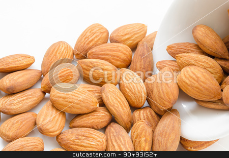 Almond in white bowl. stock photo, Almond in white bowl on white background. by Miss. PENCHAN  PUMILA
