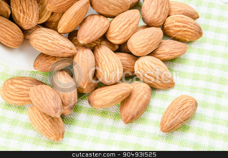 Fresh almond stock photo, Fresh almond in white bowl on tablecloth. by Miss. PENCHAN  PUMILA