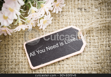 All you need is love. stock photo, All you need is love vintage wood tag with flower on sack background. by Miss. PENCHAN  PUMILA