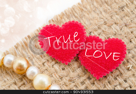 Ture love motto. stock photo, True love in red heart on sack background with beautiful bokeh. by Miss. PENCHAN  PUMILA