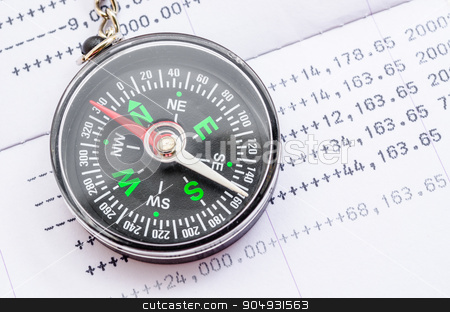 Financial direction concept. stock photo, Compass and book bank statement. Financial direction concept. by Miss. PENCHAN  PUMILA