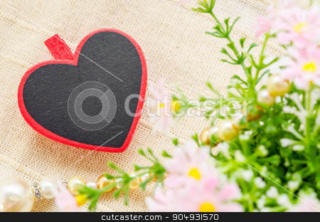 Love concept. stock photo, Blank wooden heart shape tag with flower on fabric background for your text. Love concept. by Miss. PENCHAN  PUMILA