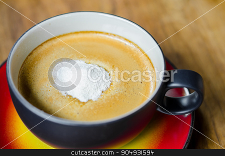 Creamer on a cup of coffee stock photo, Creamer on a cup of coffee on wooden background. by Miss. PENCHAN  PUMILA