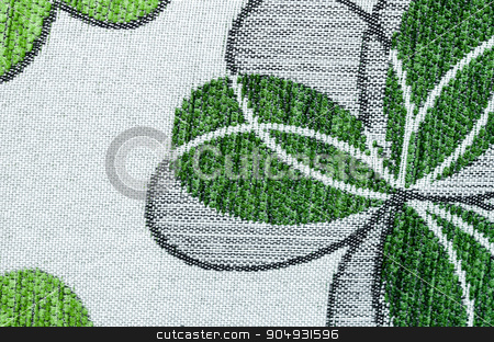 Embroidery of green leaf on linen beige fabric. stock photo, Embroidery of green leaf on linen beige fabric can use as background. by Miss. PENCHAN  PUMILA