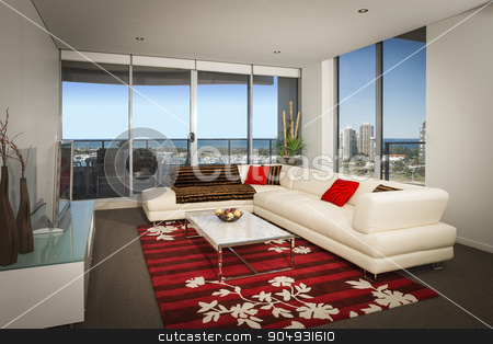 White sofa in a spacious living room stock photo, Image of a white sofa in a spacious living room with big windows overlooking the city by JRstock
