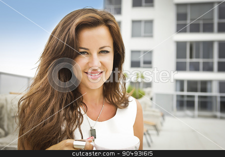 Portrait of a beautiful brunette stock photo, Portrait of a beautiful brunette wearing a white shirt, taken in a courtyard of a condominium by JRstock