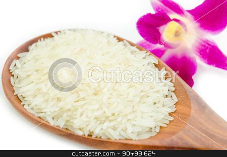 Thai Fragrant Jasmine Rice. stock photo, Thai Fragrant Jasmine Rice in a wooden spoon with Orchid Flower on white background. by Miss. PENCHAN  PUMILA