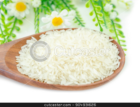 Jasmine rice in wooden spoon. stock photo, Jasmine rice in wooden spoon and white flower on white background. by Miss. PENCHAN  PUMILA