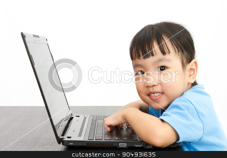 Chinese little girl using laptop stock photo, Chinese little girl using laptop in plain isolated white background. by Tan Kian Khoon