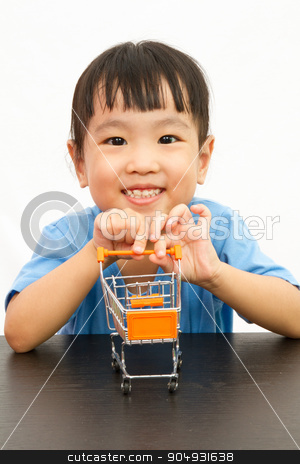 Chinese little girl pushing a toy shopping cart stock photo, Chinese little girl pushing a toy shopping cart in plain white isolated background. by Tan Kian Khoon